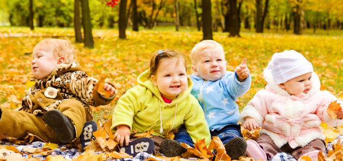 Babies group having fun in fall